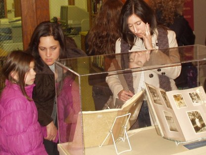 Visitors view the Frank family scrapbook.
